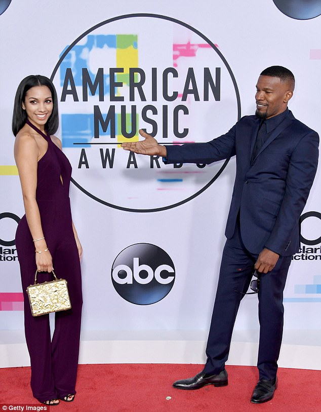 Proud father: Earlier in the night he arrived with his daughter Corinne, 23, to the American Music Awards at the Microsoft Theatre in Los Angeles on Sunday