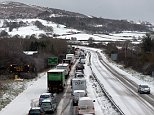 Traffic grinds to a halt in front of a wintry backdrop on the A55 in Wales following an accident in blizzard conditions