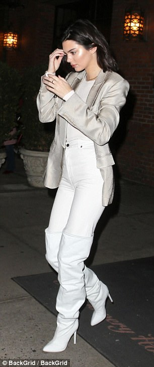 Angel: She showed off her supremely slender waistline with a bright white T-shirt tucked into her jeans