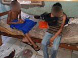 Squalid conditions: The three boys and two girls aged between six and 14 were rescued from their gruesome confinement in a locked room in Cuiaba, central west Brazil, on Friday after begging neighbours to help them escape