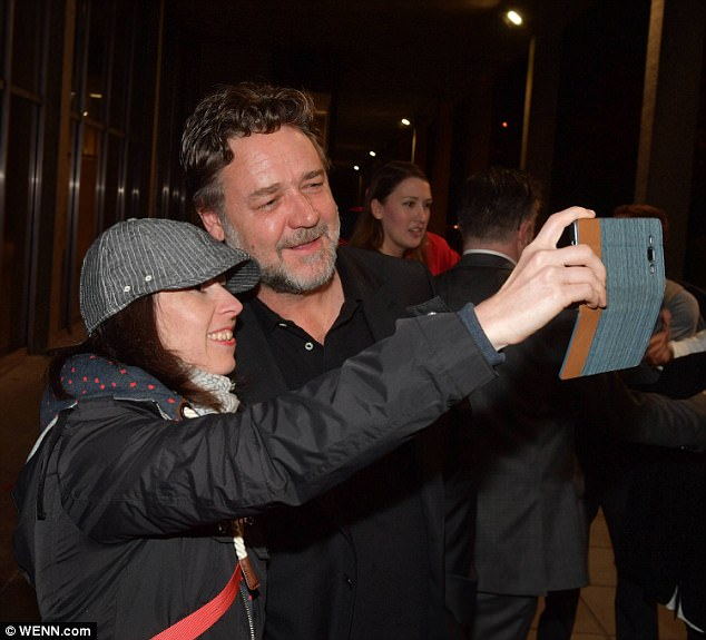 Kind: He happily posed for photos with fans