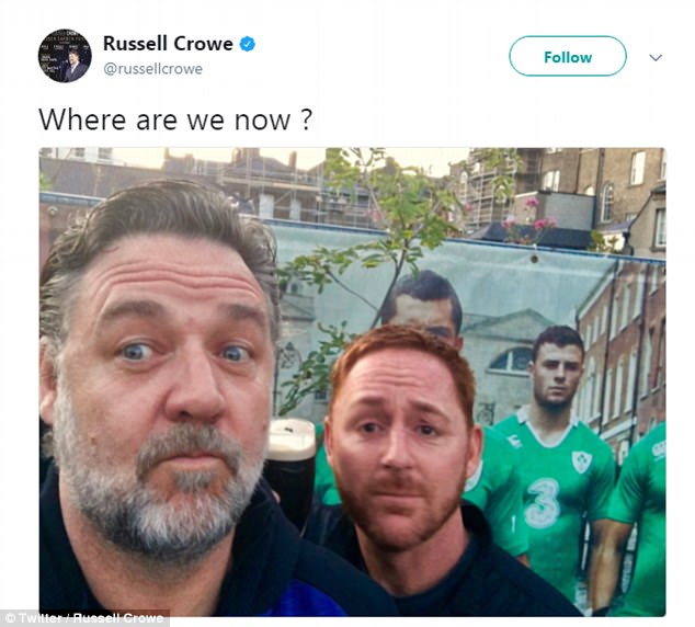 Making music:The Indoor Garden Party band have enjoyed larking about and experiencing true Ireland during their stint in the capital - as evidenced by a photo of Russell fellow actor and musician, Scott Grimes, in what appeared to be a pub earlier today (pictured)