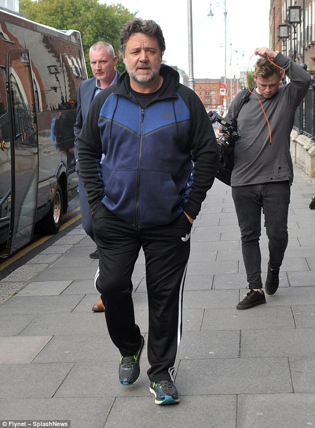 Relaxed:The Les Miserables star, 53, looked comfortable in the loose-fitting active wear - and reminded passerby of his intense intellect with a pair of glasses perched studiously on his nose