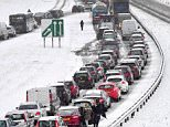 Heavy snow brought traffic to a halt near Rettendon, Essex, yesterday after parts of Britain were covered in up to 13in of snow