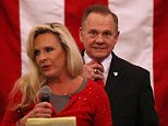 Kayla Moore (left), the wife of embattled Senate candidate Roy Moore (right), said Monday night that the couple's 'lawyer is a Jew,' as evidence that her husband isn't anti-Semitic