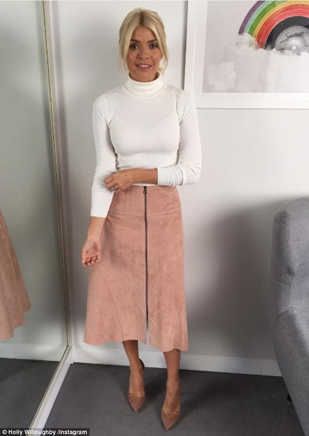 Svelte: Holly Willoughby once again wowed fans as she posted her daily outfit snap - in which she was displaying possibly her slimmest look to date while sporting a tight white jumper with a chic A-line skirt on Thursday