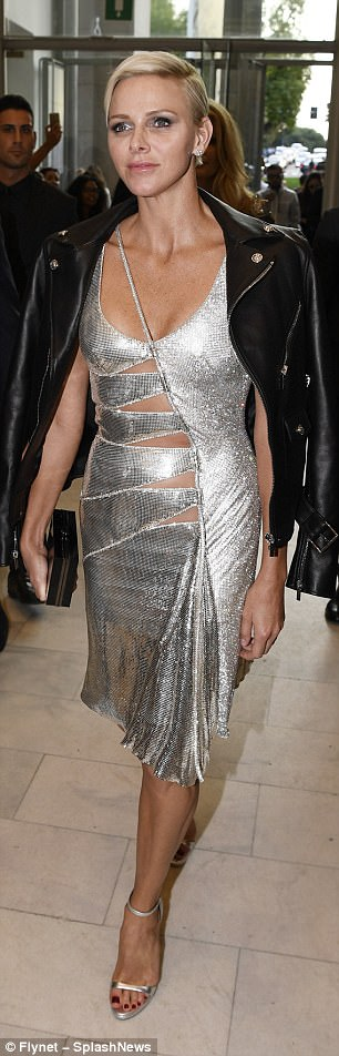 Regal: Her gorgeous silver dress was slashed at the middle to reveal her toned frame