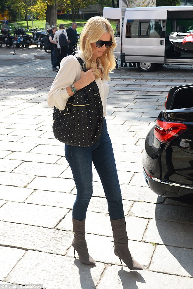 Leggy lady: Claudia clad her endless pins in a pair of skinny jeans and heeled boots