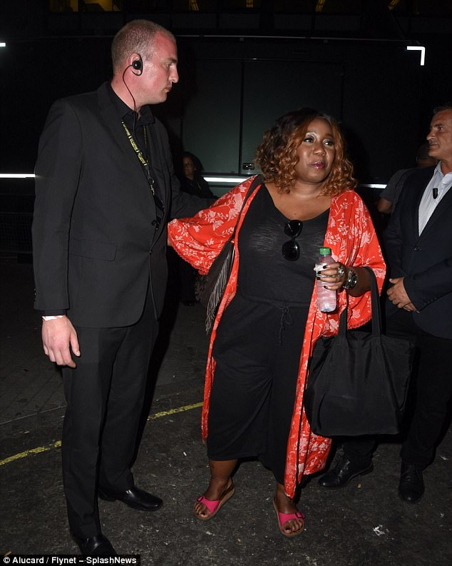 Wow: Chizzy Akudolu, meanwhile, caught the eye in a floral scarlet wrap which she threw over her form-fitting black jumpsuit
