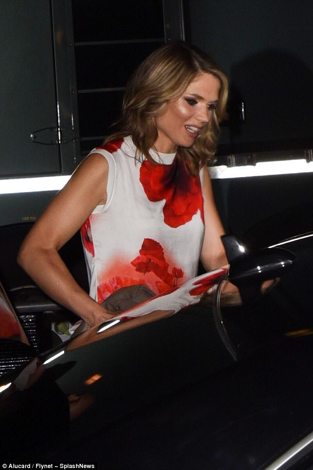 End of the night:The newsreader was effortlessly elegant in the poppy print dress