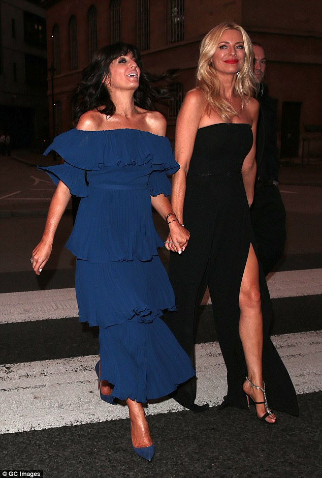 Chic: Claudia opted for a tiered navy dress which fell to the floor in pleats, and matched it to her court heels