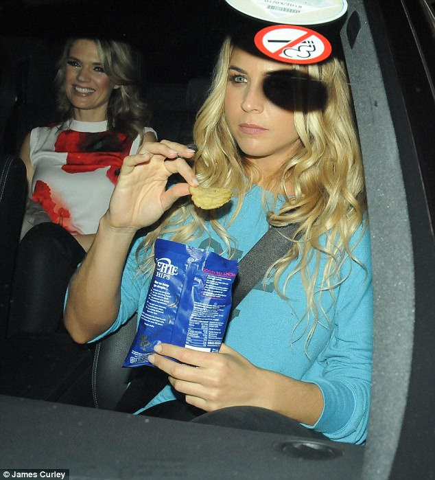Concentration: Gemma Atkinson, 32, refuelled with a bag crisps after dancing the night away at the BBC studios in London after the Strictly Come Dancing launch on Monday