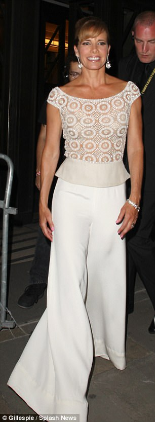 Making a statement: Darcy Bussell wore a pair of wide leg white trousers which skimmed over her legs