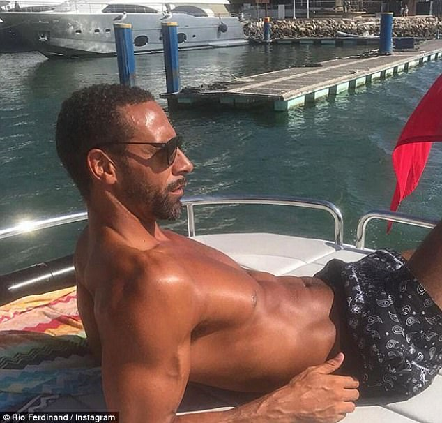 Hunky: Rio shared a shirtless snap of himself reclining on a boat but keeping coy about his romance he captioned the shot: 'Decent day with the family on the boat... just taking in some much needed sun!'
