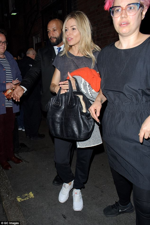 Here she comes: The glamorous departures that have so far defined her hugely successful West End run were surprisingly put on hold as Sienna Miller greeted fans on Saturday evening