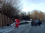 Ouch! A woman walking on the slippery pavement takes a painful fall onto the hard icy pavement in Watford, Hertfordshire