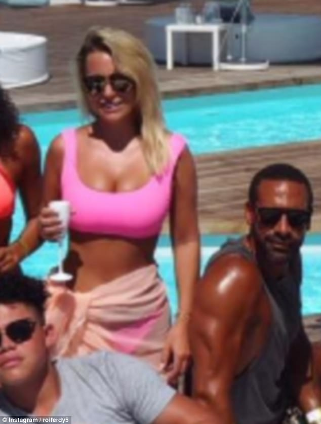 Glam: Rio Ferdinand appears to finally be ready to go fully public with his TOWIE star girlfriend Kate Wright as he shared the first ever snap of the duo on either his or her Instagram on Saturday - as they chilled with his family on holidayat Blanco Beach Club in Portugal