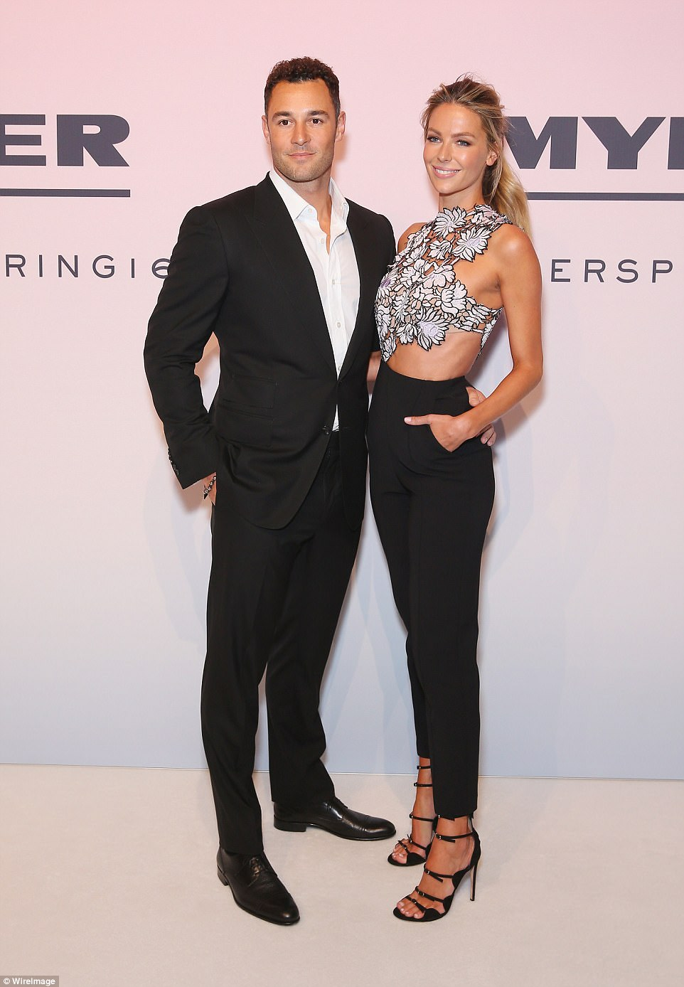 One of many: Having become a property mogul in the years since she won Miss Universe in 2004, Jennifer and husband Jake Wall (pictured) are believed to still have three other investment properties