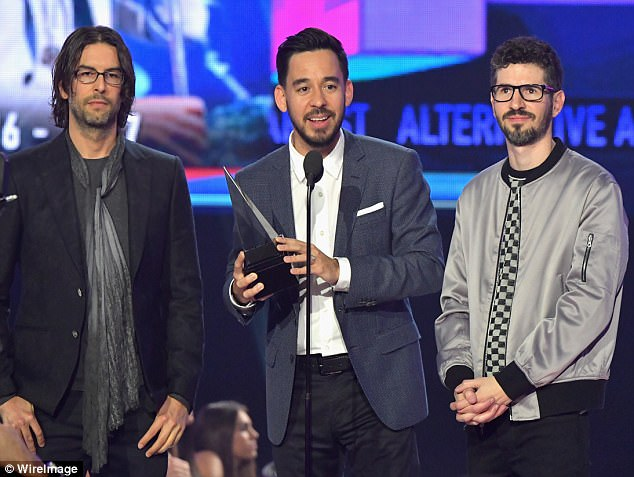 Tribute: Linkin Park's remaining members - Mike Shinoda, Rob Bourdon and Brad Delson -  honored their late lead singer Chester Bennington on Sunday night at the AMA