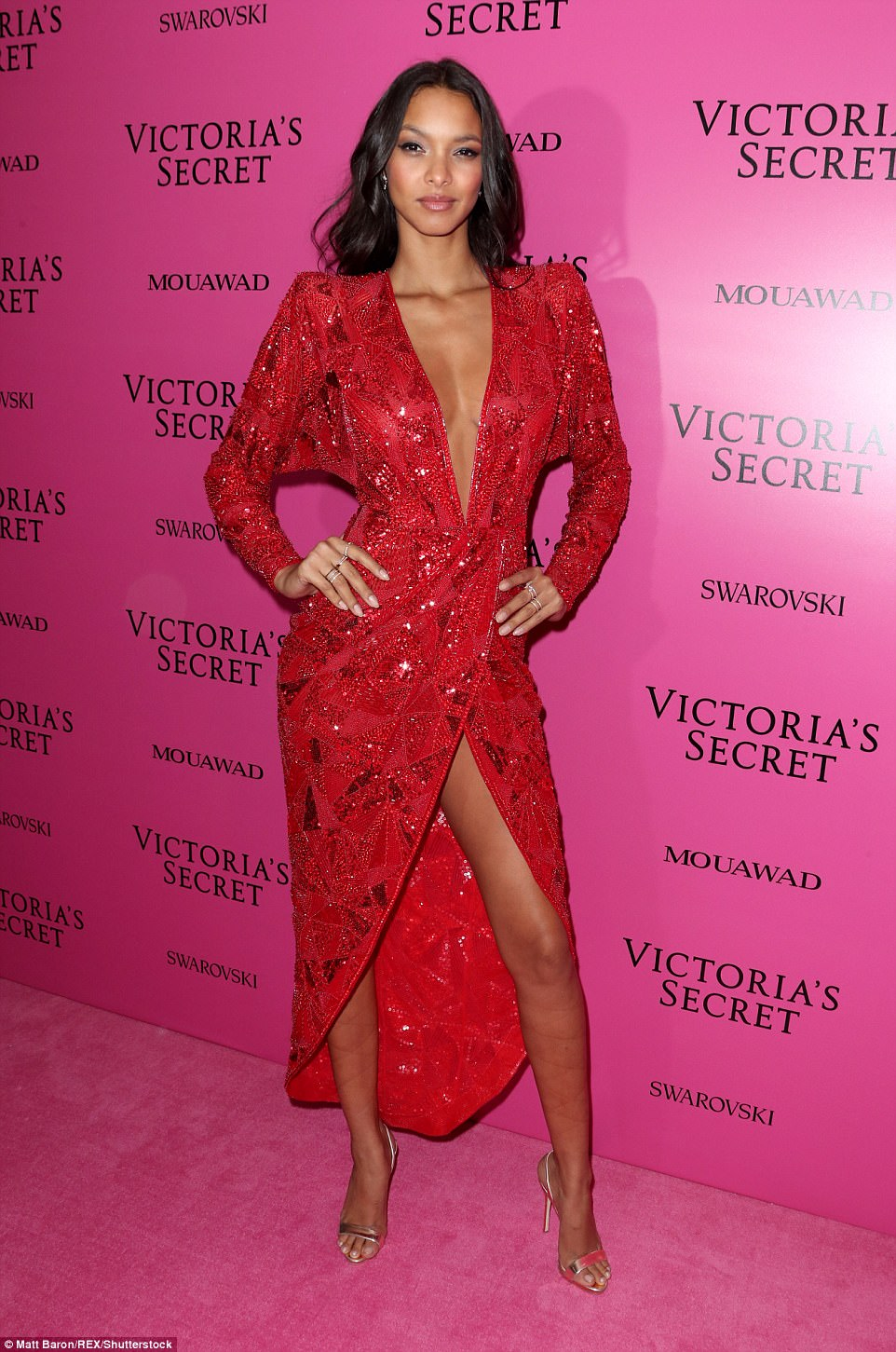 Red hot: Alessandra wasn't the only one who put on a sexy display at the after party, as Lais Ribeiro commanded attention in a perilously plunging sequinned red dress