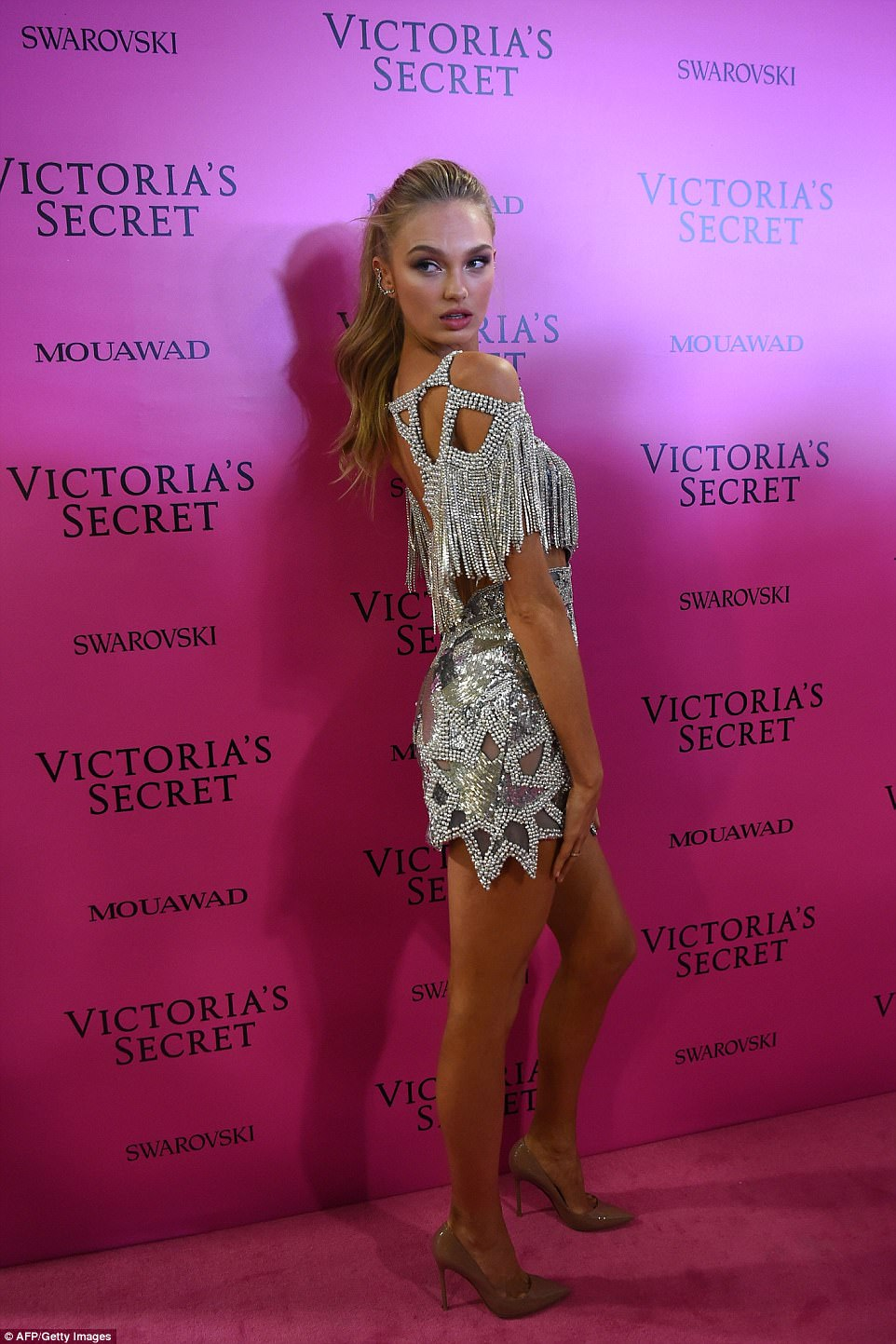 Toned: Romee Strijd looked sensational in a silver tasselled minidress paired with chic chestnut heels