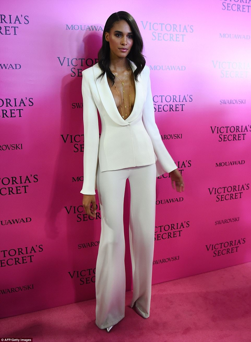 Busty: Cindy Bruna put on a seriously busty display in a plunging white suit, which she teamed with a pair of flared white trousers and pointed silver heels