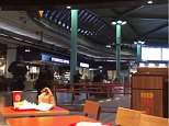 Police patrol Amsterdam's Schiphol Airportafter a man wielding a knife was shot by military police