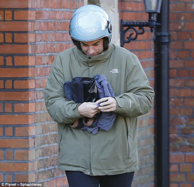 Focused:The star bundled up in a green jacket and black chinos as he left Gemma's house, turning around at one point and bidding farewell to his ex flame