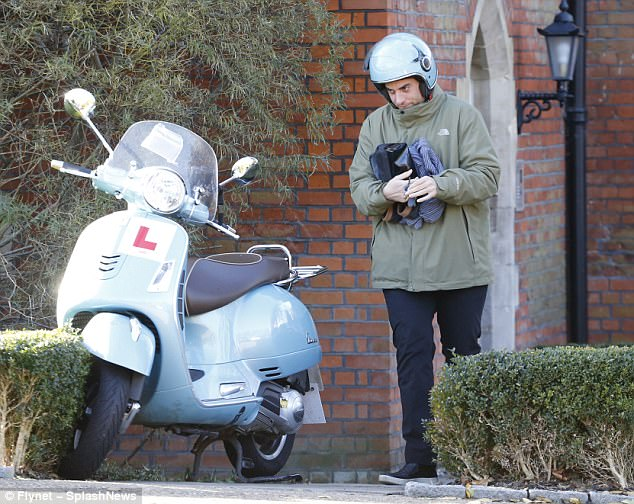 Sleepover? Arg, 29, who appeared to be clutching onto his underwear and slippers, cut a solemn figure as he bowed his head while walking to his moped, his face mostly covered by a silver helmet
