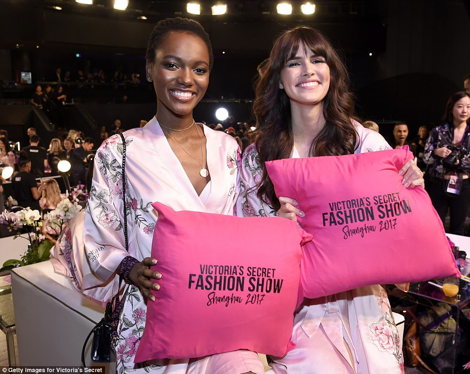 Excited! She and fellow Angel Herieth Paul showed off their Victoria's Secret cushions while backstage at the show