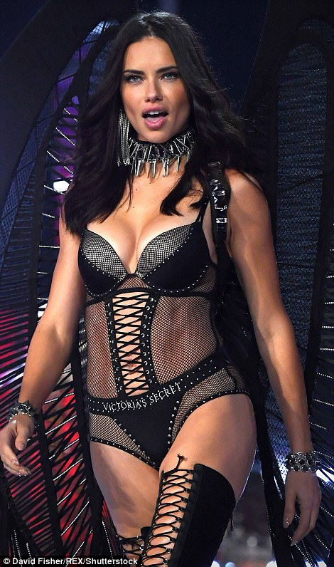Sheer delight! It was hard to believe the stunning model is a mother-of-two as she showed off every inch of her tanned and toned physique in another sexy ensemble - a sheer black bodysuit that was teamed with towering thigh high boots