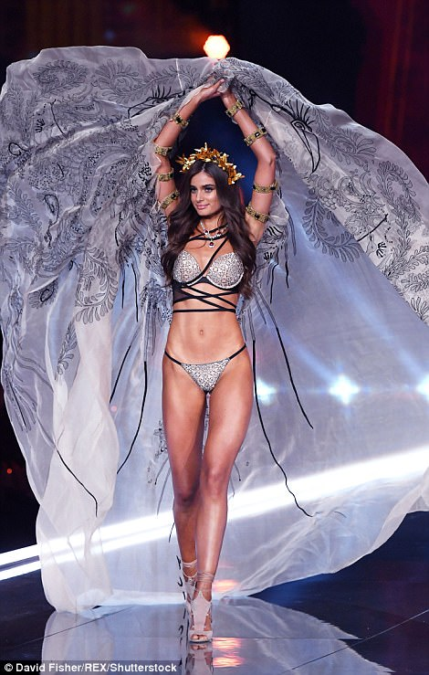 Sensational: The stunning model flaunted her fantastic figure in skimpy lingerie as she stormed the runway