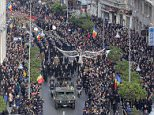 Soldiers carry the coffin of late Romanian King Michael during a funeral ceremony in Bucharest
