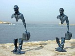 Two of the sculptures at the waterfront in Marseille by French artist Bruno Catalano