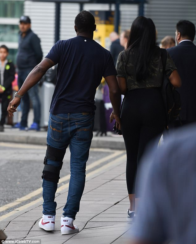 Still hobbling: Idris looked to be still in pain as he painfully hobbled on his injured leg