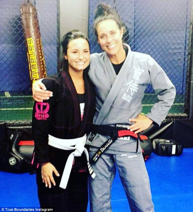 Girls in gi's! Demi sent pal and mentor Danielle Martin. '[Thanks to] one of the most important and special women in my life today @officialdaniellemartin / @trueboundaries'