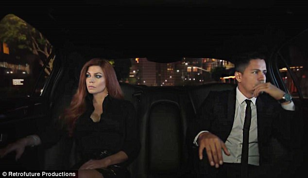 Private: In another scene, they're both in swank evening-wear, staring frostily away from each other as they sit as far apart as possible at the back of a car