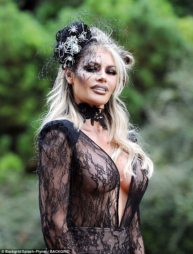 Gothic glamour: Chloe Sims showed off a liberal amount of skin, donning a sheer plunging catsuit to filma spooky TOWIE Halloween special at Hockwold Hall in Norfolk on Wednesday