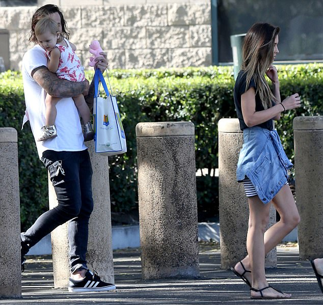 Co-parenting: The now-divorcing pair were spotted exchanging custody of daughter Kirra for Bohan's day of visitation, later meeting up for Audrina to take the little one home