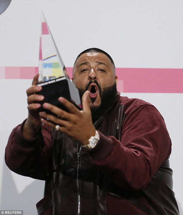 The thrill of victory:DJ Khaled was elated as he posed with his trophy forI'm The One, which was named the Favorite Song in Rap/Hip-Hop