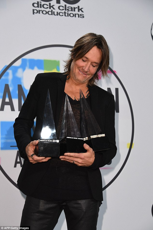 Handful: Country superstar Keith Urban had his hands full with three trophies on the evening
