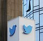 This Wednesday, Oct. 26, 2016, photo shows a Twitter sign outside of the company's headquarters in San Francisco. Twitter will be enforcing stricter policies on violent and abusive content such as hateful images or symbols, including those attached to user profiles, the company announced Monday, Dec. 18, 2017. (AP Photo/Jeff Chiu)