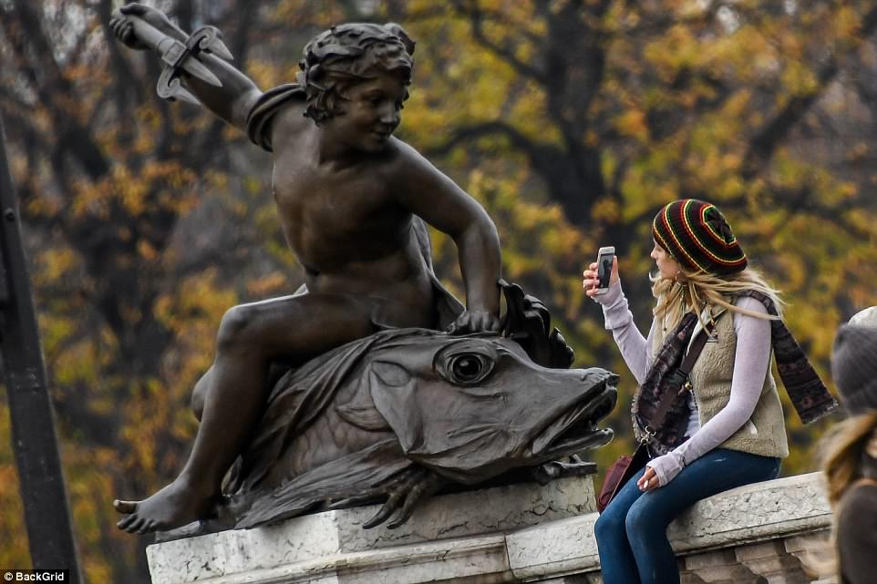 Culture vulture: Paris couldn't resist taking a photo of a statue as she continued her cultural trip abroad