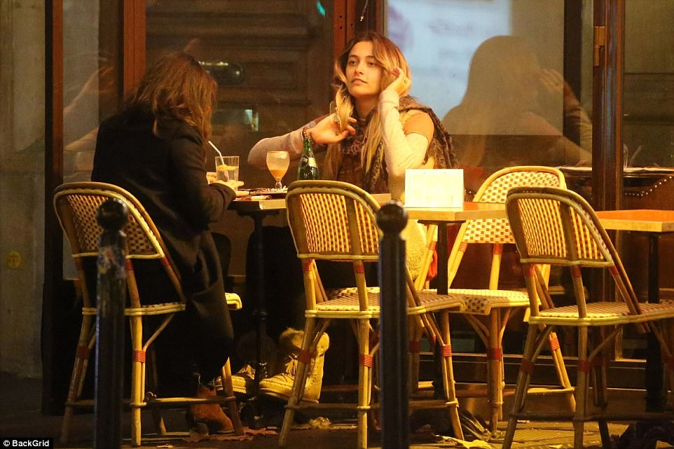 Catching up: Paris caught up with a friend as she enjoyed an evening of leisure after her day of sight-seeing