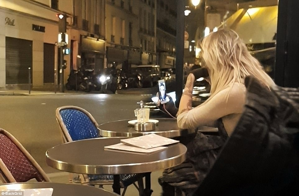 Who's that? Paris spent time FaceTiming a handsome pal as she enjoyed an alfresco meal in the city
