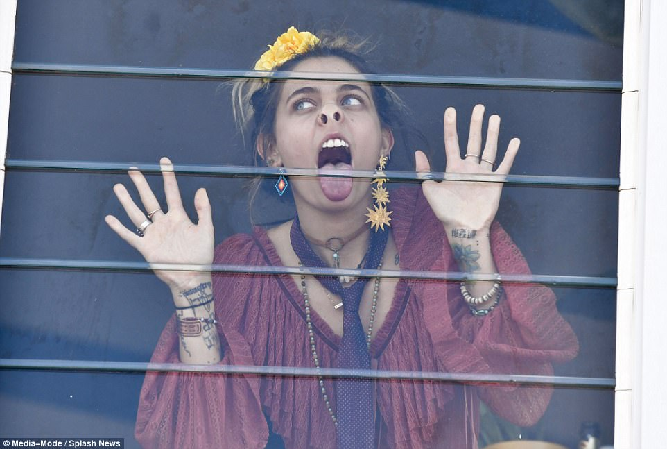 Eccentric:The trip came a month after Paris was seen licking a window inside a Melbourne Cup marquee, leading the Herald Sun to post the said image alongside the headline 'Wacko Jacko 2.0'- which she lambasted