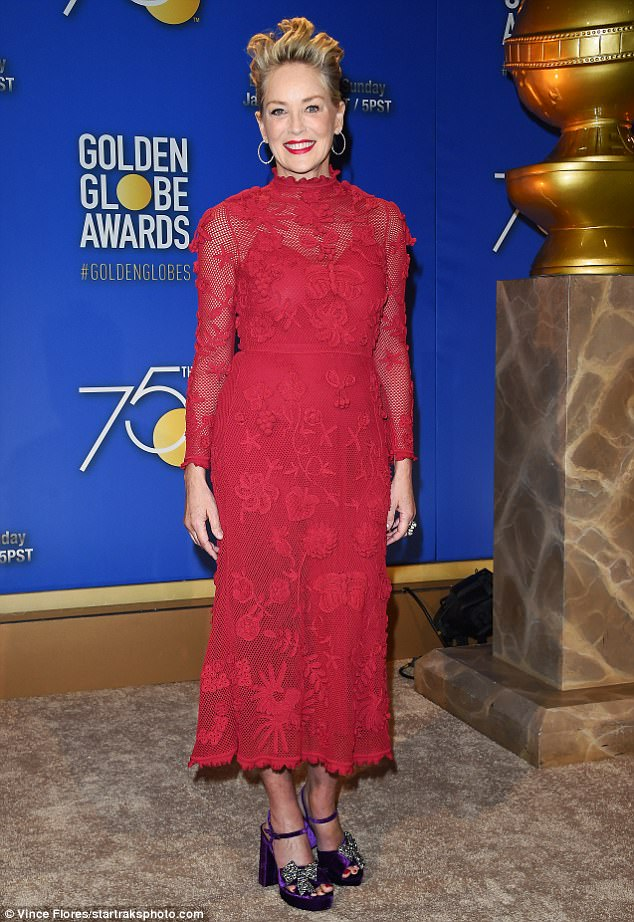 Bold look: Sharon Stone wore a red lace dressas she announced some of the Golden Globe nominations from the Beverly Hilton Hotel in Beverly Hills