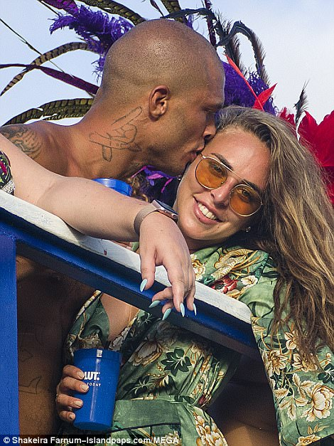 Canoodling: The pair could not stop smooching and packing on the PDA at the carnival