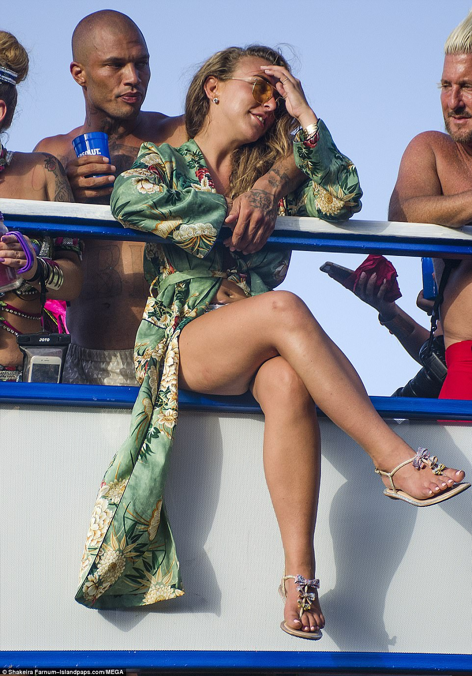 All eyes on me: Chloe later swapped her towering heels for comfy sandals as she relaxed