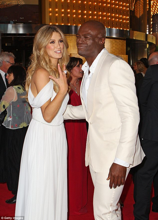 From colleagues to room-mates? Woman's Day magazine has claimed that Seal is living with Delta Goodrem after moving in to the blonde beauty's LA apartment